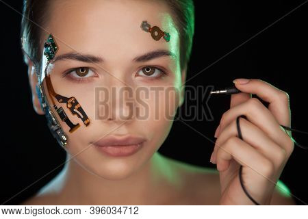 Portrait Of A Beautiful Womans Face With Half Human Face And Half Face Robot.