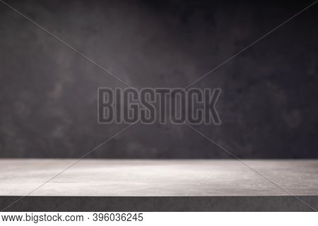 wooden table or tabletop near wall background, front low angle view
