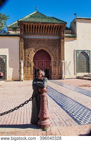 Meknes, Morocco - Oct 16, 2019: Man Sitting At Mausoleum Of Moulay Ismail In Meknes In Morocco. Maus