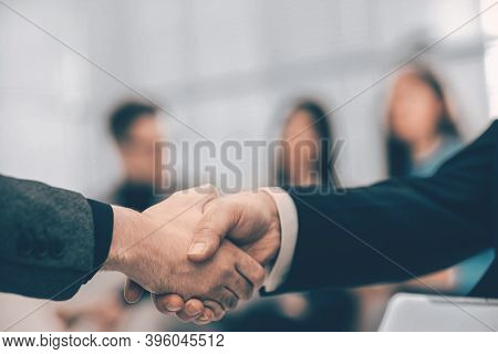 Close Up. Business Handshake On An Office Background.