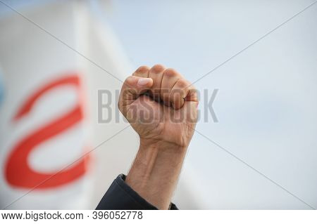 Details With The Closed Fist Of An Angry Protestor During A Political Rally.