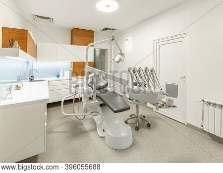 Stomatology Interior Of Dental Clinic With Professional Chair. Stomatology Concept