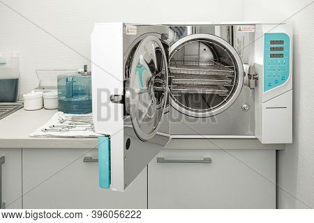 Machine For Sterilizing Medical Equipment In Autoclave. Dental Office Concept