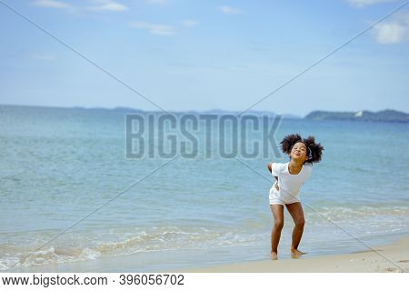 Kid Girl American African Playing Relax Enjoy Life Funny Moment On The Beach In Sea View Nature Holi