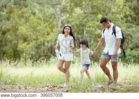 Happy Asian Family With Daughter Playing And Travel In Forest On Weekend Holidays Relaxation Adventu