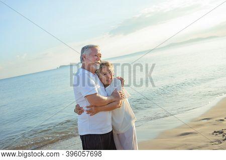 Asian Couple Senior Elder Retire Resting Embrace At Sunset Beach Honeymoon Family Together Happiness