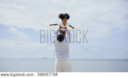 Father African American Playing With Daughter Together On The Beach Summer Vacation Family Happiness