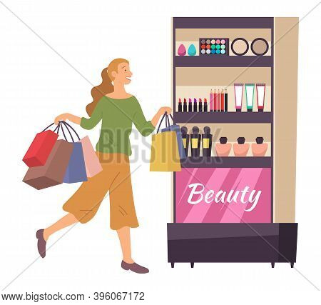 Smiling Woman With Shopping Bags. Young Girl Picks Up Multi-colored Packages With Toiletry. Female C
