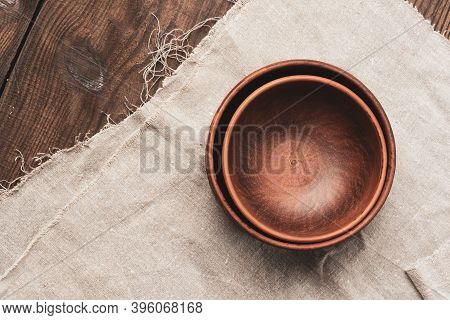 Empty Brown Ceramic Plates On A Wooden Table, Top View