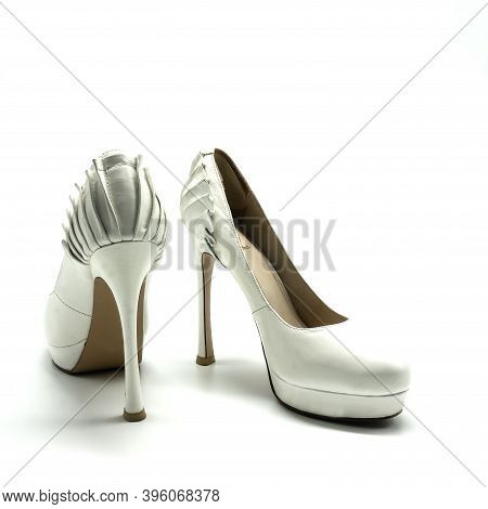 Women's White Shoes Made Of Genuine Leather. Extra High Heel And Platform. The Back Is Decorated Wit