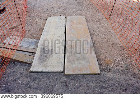 Temporary Wooden Flooring For Pedestrians To Cross The Road, A Place For Road Works And Repair Of As