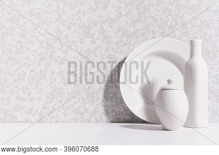 Elegant Home Decor With White Ceramic Crockery - Plate, Bottle, Pot In Morning Sunlight With Shadow