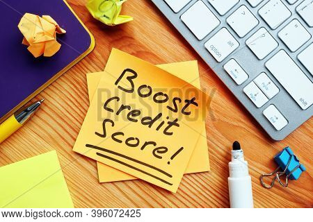 Boost Credit Score Mark On The Orange Piece Of Paper.