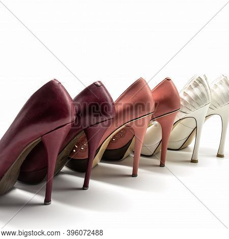 A Range Of Women's Shoes Made Of Genuine Leather With High Heels And Platform. Cherry, Pink And Whit