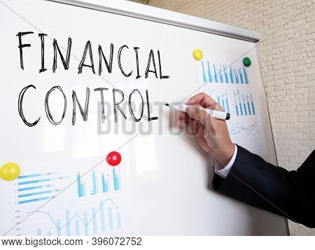 The Auditor Writes The Words Financial Control On The Whiteboard.