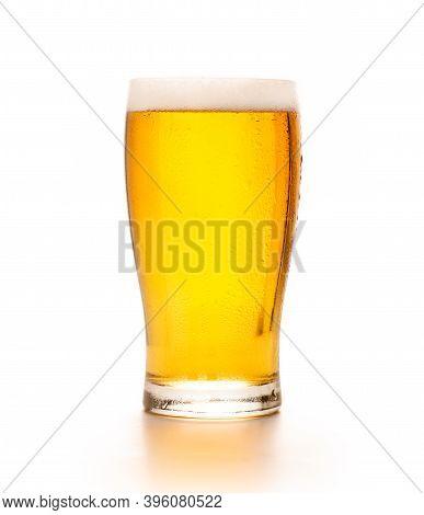 Favorite Craft Drink For Client During Beer Festival. Full Cold Glass Goblet Of Light Craft Lager Wi