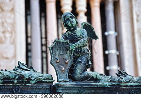 Angel With Armor On The Metal Fence Near The Cappella Colleoni (was Built With Marble Elements Betwe