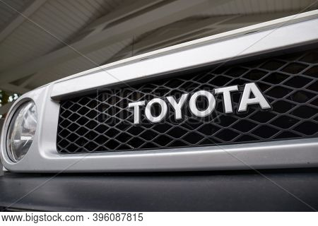 Budapest, Hungary - Circa 2020: Toyota logo on the front grill of a Toyota FJ Cruiser 4x4 4wd car