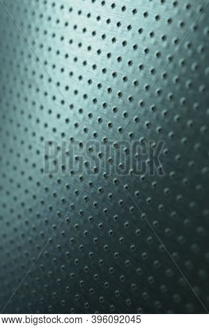 Tinted Blue Or Green Metal Background. Dark Vertical Technical Wallpaper. Perforated Aluminum Surfac