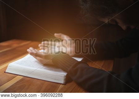 Woman Praying In The Morning. Christianity Concept. Pray Background. Faith Hope Love Concept.