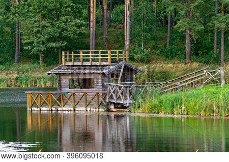 A Small Wooden House For Fishermen On The Shore Of The Lake.