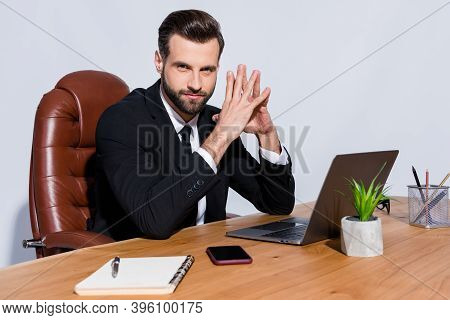 Photo Of Handsome Macho Business Guy Self-confident Person Notebook Table Hold Fingers Together Inte