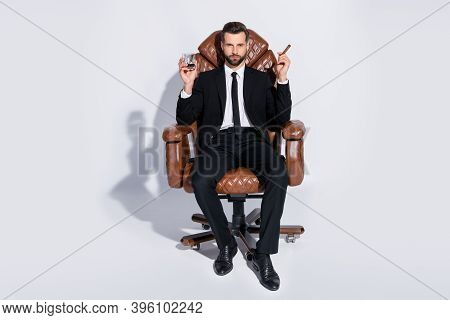 Full Body Photo Of Handsome Business Guy Sit Big Office Chair Hold Whiskey Glass Cuban Cigar Luxury