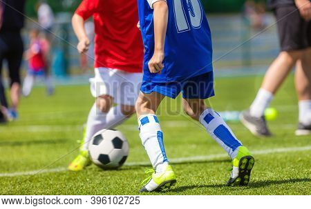 Football Soccer Match For Children. Kids Playing Soccer Tournament Game. Boys Running And Kicking Fo