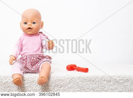 A Baby Doll And A Neurological Hammer Lying Nearby. Pediatric Medicine And Neurology Concept, Copy S