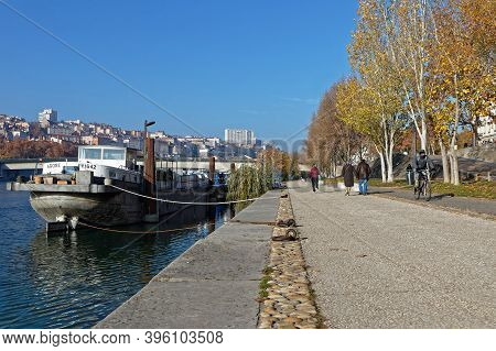 Lyon, France, November 22, 2020 : A Few People Walks On The Berges Du Rhone, A Usually Frequented Se