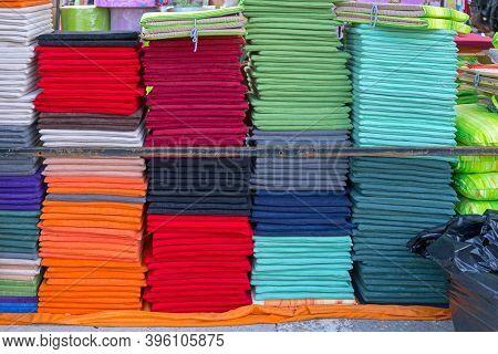 Many Colourful Seat Pads Cushions At Shelf
