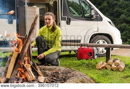Single Caucasian Woman In Her 30s With Rv Camper Van Motorhome, Camping Alone And Preparing Food On