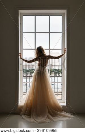 Vertical Photo Of Unrecognizable Slim Pretty Girl In Beige Wedding Chic Dress Stands In Front Of The