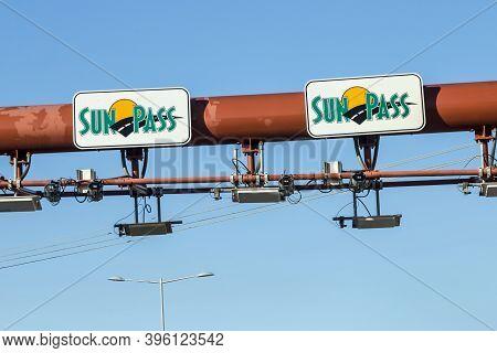 Miami, Usa - August 27, 2014: Sunpass Lane At The Miami Highway In Miami, Usa. Sunpass Lane On Left