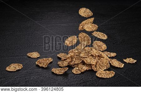 Falling Bran Flakes On Black Stone Background
