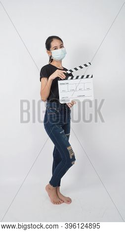 Teenage Girl Or Asian Young Woman Wear Face Mask And Hand's Holding Clapper Board Or Movie Slate Use