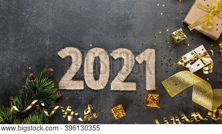 Top View. Bright Golden New Year Card With Gifts And Lettering 2021 On Dark Background, Christmas Ti