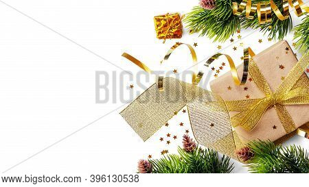Golden Ribbon And Festive Gift Wrapping, Christmas Tree Branch Isolated On White Background