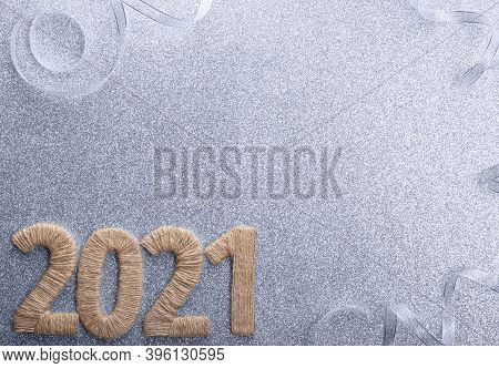 New Year 2021 Twine Inscription On Silver Sparkling Background With Bright Ribbon