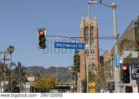 Hollywood, Usa - Mar 17, 2019: Street Sign Hollywood Bl In Los Angeles Under Blue Sky.