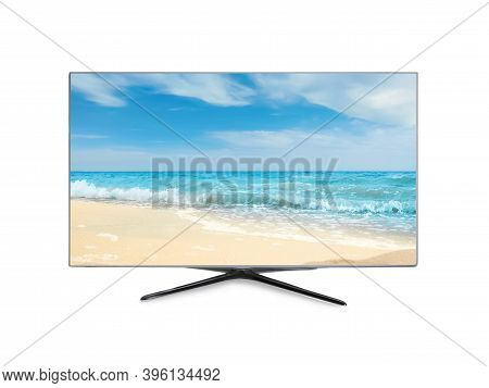 Modern Wide Screen Tv Monitor Showing Ocean And Sandy Beach, Isolated On White