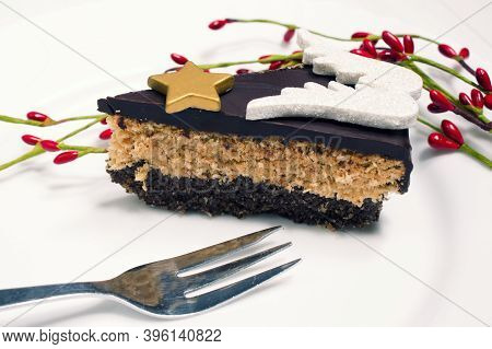 A Piece Of Coconut Cake With Chocolate Prepared From Quality And Healthy Ingredients. The Cake Is De