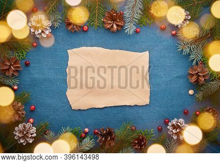 Christmas And Happy New Year Dark Blue Background With Craft Paper For Text And Bokeh Of Light Garla