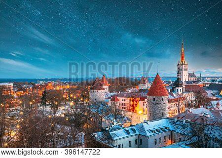 Tallinn, Estonia. Night Starry Sky Above Old Castle Walls Architecture. Cityscape Skyline In Old Tow
