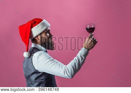 Santa With Glass Of Wine. Red Wine. Santa With Alcohol. Man In Suit Drinks Wine. Alcohol. Wine. Man