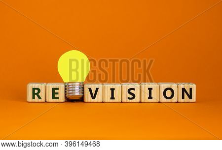 Wooden Cubes With Word 'revision'. Yellow Light Bulb. Beautiful Orange Background. Business And Revi