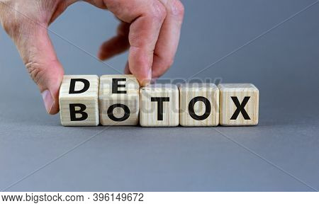 Detox Vs Botox. Hand Turns Cubes And Changes The Word 'botox' To 'detox' Or Vice Versa. Beautiful Gr