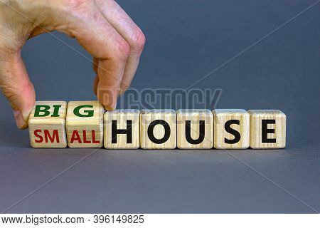 Big House Or Small House. Hand Turns Cubes And Changes Words 'small House' To 'big House'. Beautiful