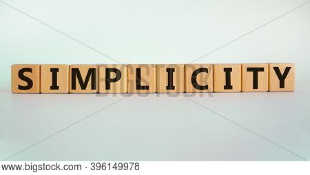Simplicity Concept. Wooden Cubes With Word 'simplicity'. Beautiful White Background. Business And Si