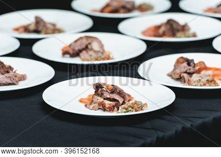 Served Homemade Bone-in Prime Rib Roast On White Plate